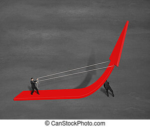 Businessmen pulling up growing red arrow - Businessman...
