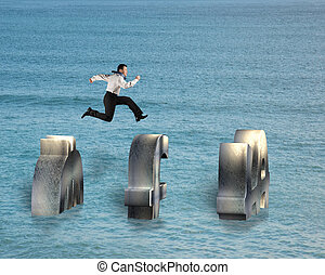 businessman jumping on money symbol over water