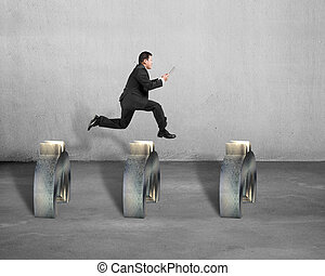 businessman jumping over euro symbol concrete background