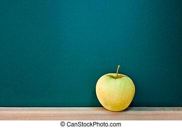 Green apple on empty chalkboard, add text to chalkboard