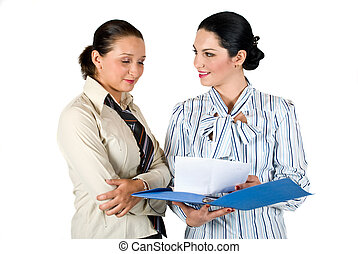 Two business woman working - Two young woman working with...
