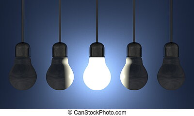 Glowing light bulb among dead ones in lamp sockets hanging...