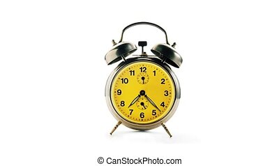Vintage alarm clock over a white background.