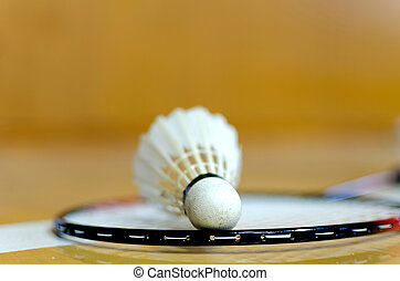 Shuttlecock on badminton racket on line