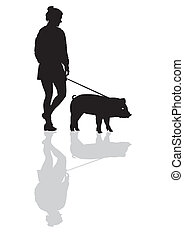 Woman with a pig on a leash