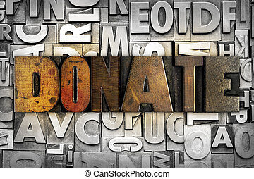 Donate - The word DONATE written in vintage letterpress type