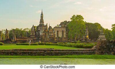 Ruins of ancient Buddhist temples in the evening Thailand,...