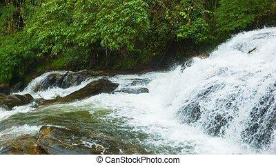Beautiful waterfall near the town of Chiang Mai, Thailand -...