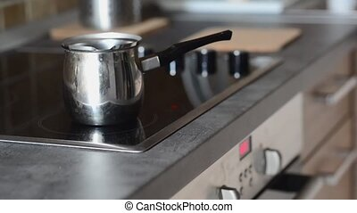 Coffee pot on cooking plate with boiling water in Making...