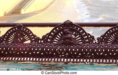 Antique bench at sun down, decorative iron work Victorian...