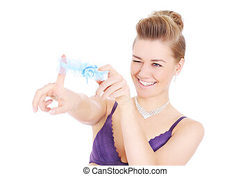 Woman playing with garter