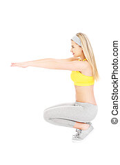 Woman doing squats - A picture of a young fit woman doing...