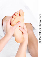 Foot massage - A picture of a person giving a foot massage