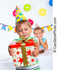 Boy with giftbox at birthday party