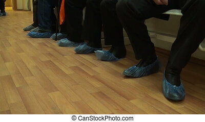 Feet in the Shoe covers. Patients on admission to the...