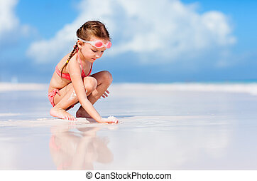 Adorable little girl at beach on summer vacation