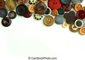 Vintage Button Collection Bordering White Background - a...