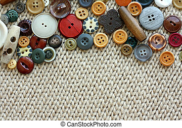 Vintage Sewing Buttons Framing Fabric Background - a natural...
