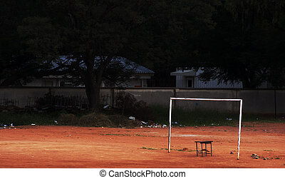 dilapidated soccer field - old dilapidated grassless soccer...