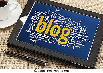blog word cloud on digital tablet - cloud of words related...