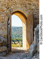 arch in the fortress - old wooden arch in the fortress with...