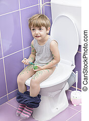 Baby on the Toilet - Cute baby on toilet drawing himself