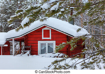 Red wooden finnish house in the forest. - Red wooden Finnish...