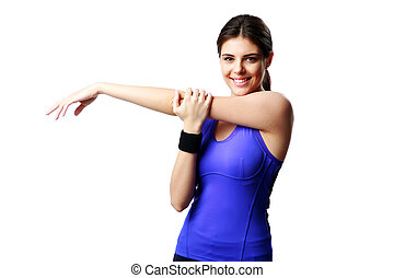 Young happy sport woman stretching hands isolated on white...