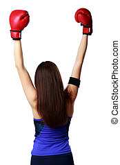 Back view portrait of a young woman wearing boxing gloves...