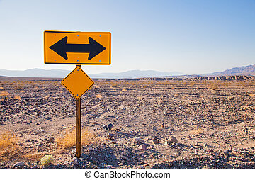 Directions - Death Valley, California. Direction sign in the...