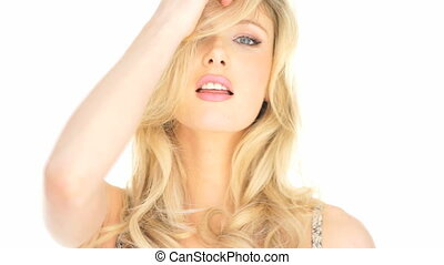 sexy blonde woman playing with her hair