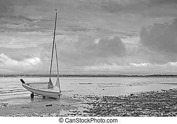 Dinghy on Beach - Black and white image of dinghy on beach
