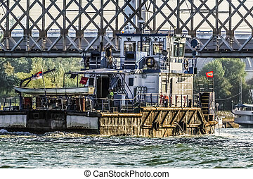 Old Towboat - Photograph of an old, powerful towboat.