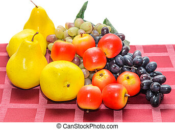 fruit on a red tablecloth - ripe fruit apple pear grapes on...
