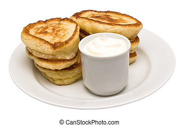Fritters with sour cream - Fried fritters on plate with sour...