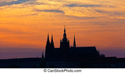 Silhouette St Vituss cathedral against a sunset, Prague