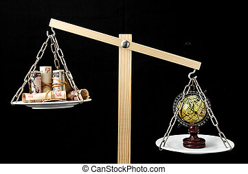Earth and Money on a Two Pan Balance - Globe Planet Earth...