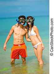 Snorkelling At Beach - A young couple with snorkelling gear...