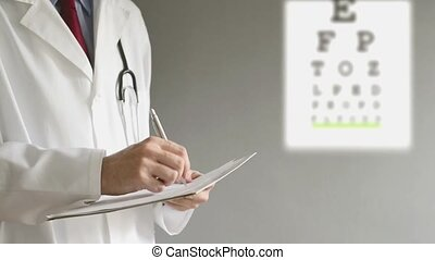 Male ophthalmologist doctor writing prescription to patient...
