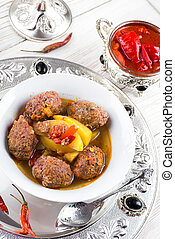 Turkey cutlets with pepper pot on the eastern
