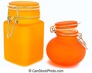 glass jars - two orange glass jars over the white background...