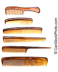 combs - many brown combs at the white background