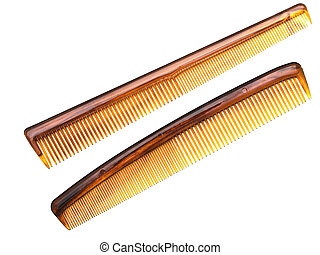 combs - two brown combs at the white background
