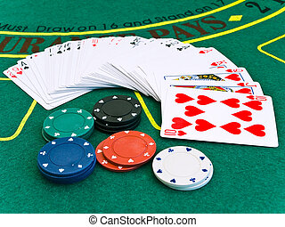 card deck and a few different chips on the playing table in...