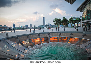 Singapore city skyline finacial district with water play in...