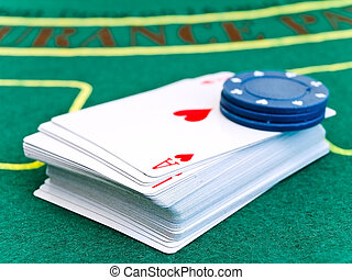 playing cards and the chips at the green table into the...