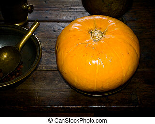 pumpkin - yellow pumpkin on the table in an old house