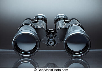 binoculars - close up of binoculars on gray background