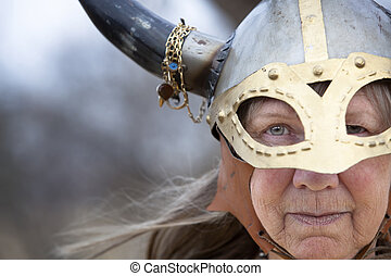 Viking Woman - Closeup portrait of Viking woman in helmet...