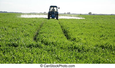 tractor pesticide - Tractor spray fertilize field with...
